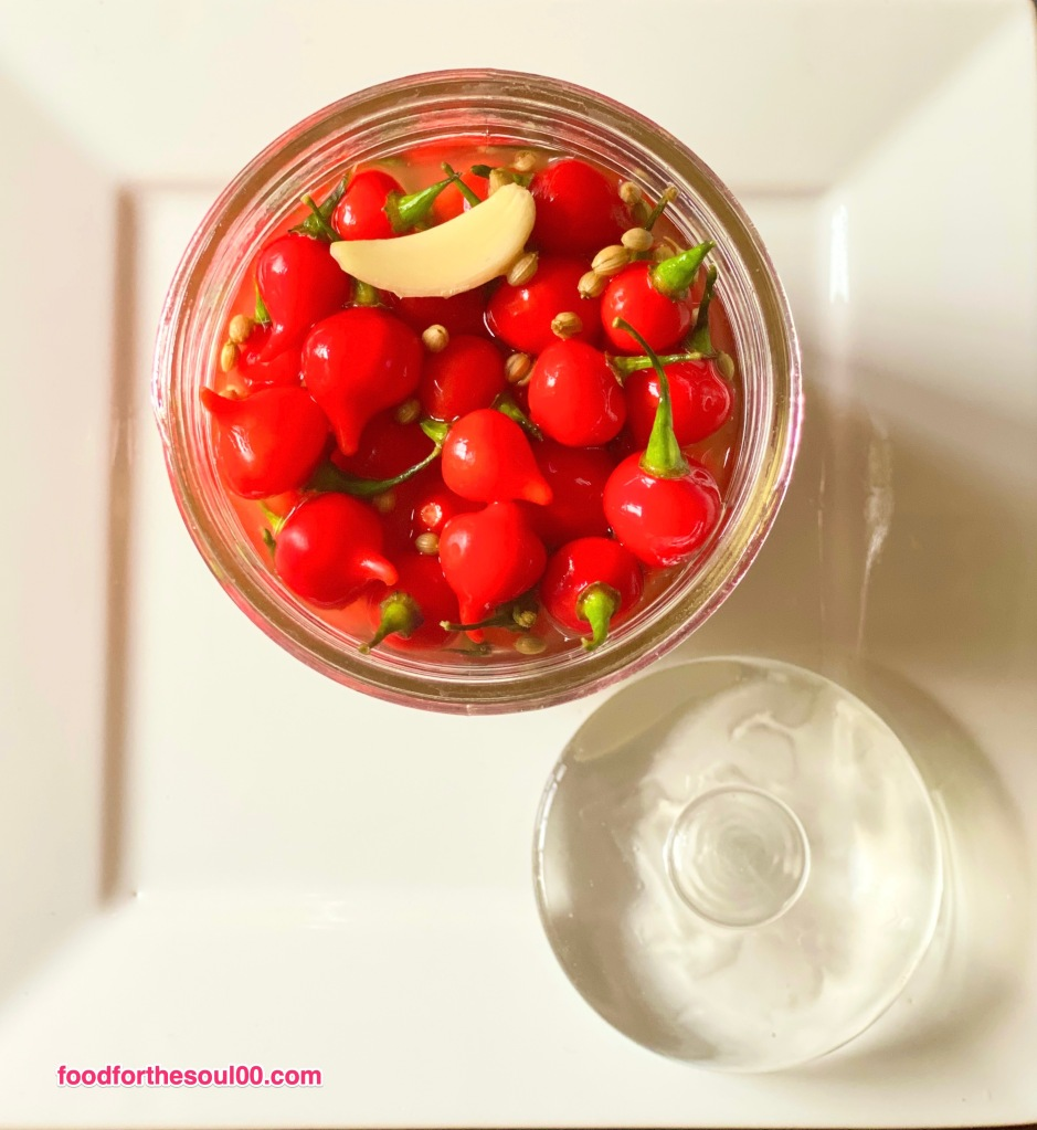 A beautiful way to preserve your summer harvest mini peppers with salt and vinegar